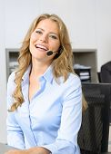 Lovely woman with headset in an office