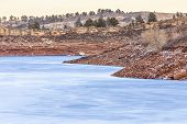 pic of horsetooth reservoir  - frozen lake with red cliffs  - JPG
