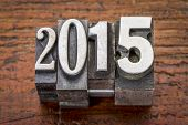 2015  - New Year concept  - text in vintage metal type over gungre wood