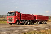 Red Volvo FH16 540 With Full Trailer On The Road