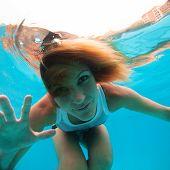 Female With Eyes Open Underwater