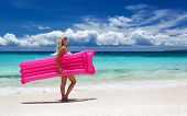 Woman With Pink Swimming Mattress On Tropical Beach, Philippines