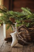 Handmade Christmas sock and basket with pine cones