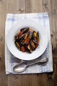 Mussel With Tomato Chorizo Sauce On A Plate