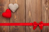 Valentines day background with toy hearts, red ribbon and copy space