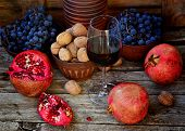 picture of walnut-tree  - pomegranate walnuts and glass of wine on a wooden background - JPG