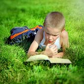 Kid Reads A Book