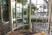 stock photo of spiral staircase  - Spiral staircase in the big modern hotel - JPG