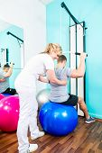 pic of physical therapist  - Patient at the physiotherapy doing physical exercises with therapist in sport rehabilitation - JPG