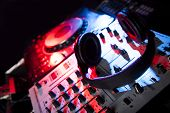 foto of mixer  - Dj mixer with headphones at nightclub light - JPG