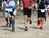 stock photo of arms race  - competitive race with many athletes involved in strenuous race - JPG