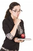 picture of shhh  - sweet female teacher holding red apple gesturing silence isolated on white - JPG