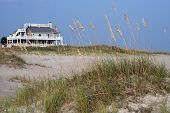 stock photo of beach-house  - A distant view of a private secluded beach house