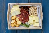 picture of cheese platter  - cheese platter on the blue wooden background - JPG