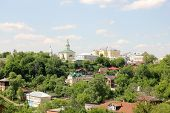 picture of backwoods  - Green residential area with a church in Vladimir - JPG