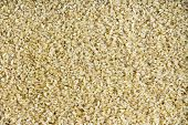 pic of staples  - Background texture of wholesome dried cracked or crushed wheat a staple cereal and grain used to speed up the cooking process full frame overhead view - JPG
