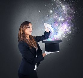 image of sorcerer  - Woman magician makes magic with her hat - JPG