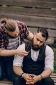 stock photo of shaved head  - two bearded men shave outdors shave brutall - JPG