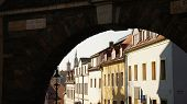 image of stone house  - View through an old town gate in Freiberg in Saxony - JPG