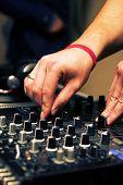 DJ adjusting music level
