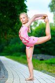 stock photo of do splits  - Image of flexible little girl doing gymnastics vertical split - JPG