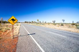 stock photo of warning-signs  - An iconic warning road sign for kangaroos near Uluru in Northern Territory - JPG