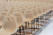 Row Of Empty Chairs Waiting To Be Occupied