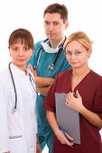 doctor with her young medical team. male and two blonde and brunette female physicians