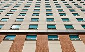 stock photo of structural engineering  - Apartment building with many windows at a university campus - JPG