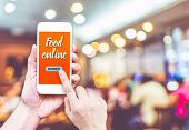 Hand Holding Mobile With Order Food Online With Blur Restaurant Background, Food Online Business Con poster