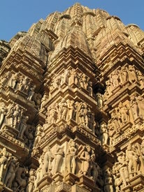 stock photo of kamasutra  - One of seven temples in Khajuraho India representing kamasutra in stone - JPG