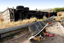 pic of truck-stop  - A truck lying on its side after its brakes failed and couldnt stop at traffic lights - JPG