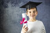 Portrait Of Young Boy With A Graduation Cap And A Diploma poster
