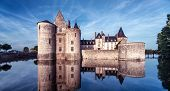 Castle Or Chateau De Sully-sur-loire At Dusk, France. This Medieval Castle Is A Famous Landmark In L poster