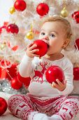 Child With A Christmas Present On Wooden Background. Happy Children. Christmas Babies. Christmas Chi poster