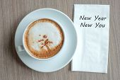 New Year New You Word With Hot Cappuccino Coffee Cup On Table Background At The Morning. New Year Ne poster