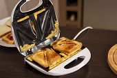 Detail Of Hot Sandwiches Ready For Eating In A Sandwich Maker. Selective Focus On The Sandwiches poster