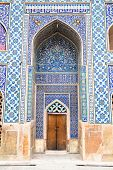 Entrance door and tiled oriental ornaments Ateegh Jame mosque's wall , Esfahan, Iran