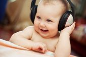 stock photo of freedom speech  - Smiling baby with headphone - JPG