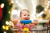Beautiful baby girl in shopping cart - trolley