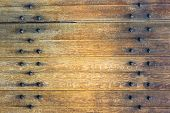 Old Wooden Background With Metal Rivets. Vintage Wooden Doors poster