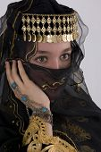 Ethnic girl wearing traditional clothing and veil