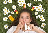 Teenage girl using nose spray for her pollen and grass allergies (Allergy relief)