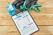 Healthy Lifestyle Concept. Mock Up On Workout And Fitness Dieting Diary With Copy Space. Food Diary  poster