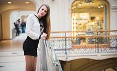 Beautiful Model Brunette Girl Posing In Clothing Store, A New Trend Of Clothes. Banner For A Clothin poster