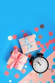 The Alarm Clock, Which Shows Almost Midnight Among The Multicolored Confetti And Present Boxes. poster