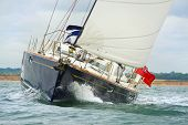 Close up of blue sailing boat, sail boat or yacht at sea with white sails poster