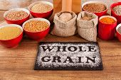 Whole Food Concept With Various Whole Grains And A Tabletop Mill poster
