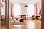 Pale Pink Living Room Interior In Tenement House, Real Photo With Copy Space On The Empty White Wall poster
