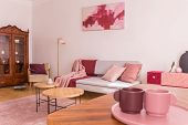 Closeup Of Two Coffee Cups On The Table In Elegant Living Room With Grey Couch With Pastel Pink Pill poster
